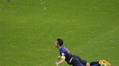 Mid-air, headed over the keeper into the back of the net. It's Robin van Persie [AP]
