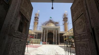 Shia volunteers slept inside the Askari shrine in Samarra defend the site from attacks by Sunni rebels [Reuters]