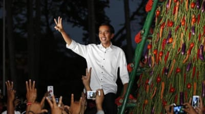 As governor of Jakarta, Joko Widodo introduced a Smart Card which helped 300,000 students from poor families [Reuters]