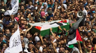 Abu Khdair was buried amid clashes between Palestinian protesters and Israeli police on Friday [EPA]