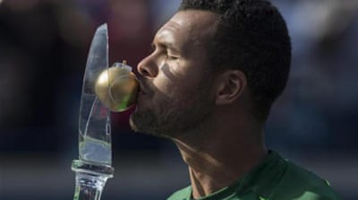 This was Tsonga's fifth win over Federer in 16 meetings [AP]