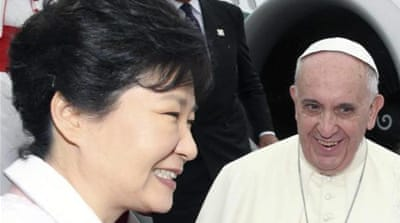 N Korea tests missiles as pope visits Seoul