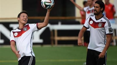 Ozil (L) and Khedira have their roots in Turkey and Tunisia [AFP]