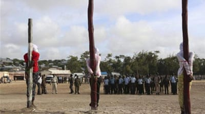 Three men found guilty by a Somali military court of killing civilians and masterminding a recent attack on the Presidential Palace were tied to poles shortly before they were executed by a firing squ