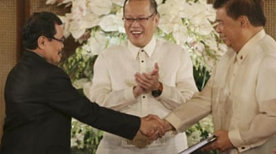 Aquino, centre, is keen to see the Moro peace deal in place before his term ends in June 2016 [AP]