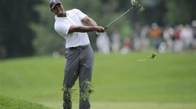 Woods is a 14-time major winner [AP]