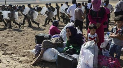 Thousands of Syrian Kurds flee ISIL