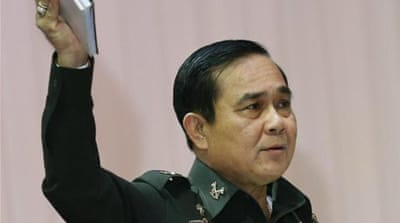 Prayuth has also penned lyrics to a patriotic ballad, 'Return Happiness to Thailand' [EPA]