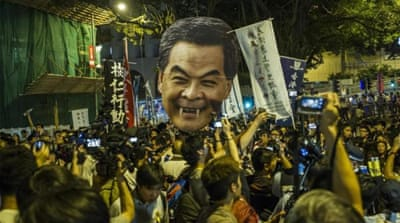 Students march on Hong Kong leader's home