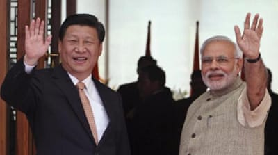 China's president embarked on a highly timely and consequential visit to India, writes Heydarian [AP]