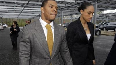 In another video, Rice was seen dragging now-wife Palmer across the floor of a hotel [AP]