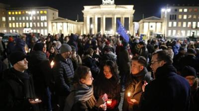 People gather to mourn for the victims near the French embassy in Berlin [Reuters]