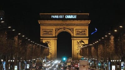'Paris is Charlie' is projected onto the Arc de Triomphe in Paris [AFP]