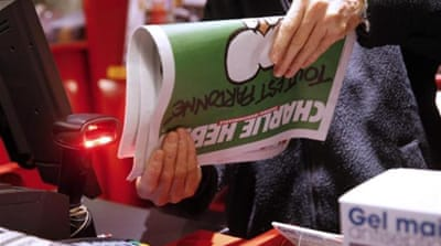 A newspaper dealer sells the new edition of the French satirical newspaper Charlie Hebdo [EPA]