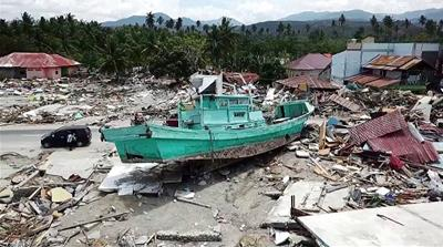 Indonesia disaster: 92 people arrested for looting