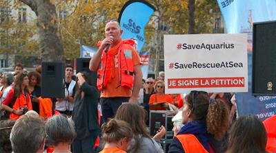 Thousands rally in Paris to support migrant rescue ship Aquarius
