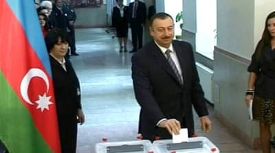 Azerbaijan's Aliyev set to win poll boycotted by opposition