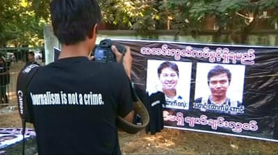 Reuters journalists investigating Rohingya deaths to face trial