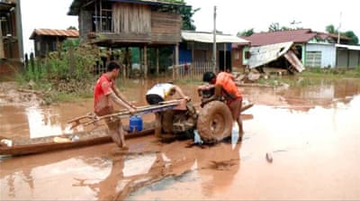 Laos dam collapse: Water levels slowly receding