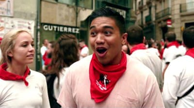 Why do people sign up for Pamplona's running of the bulls?
