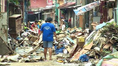 Philippines flooding: Displaced residents assess damage