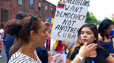 Supporters of Maduro and Guaido clash at Venezuelan embassy in US