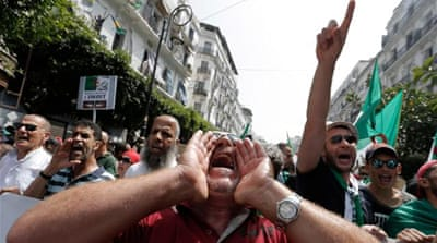 Algeria protesters demand free elections within six months