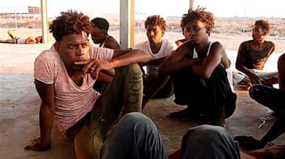 Libya to close migrant centres after criticism from UN