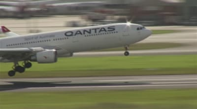 Australia's Qantas airline lays off thousands amid pandemic