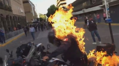 Mexico police set on fire during protests against fatal beating