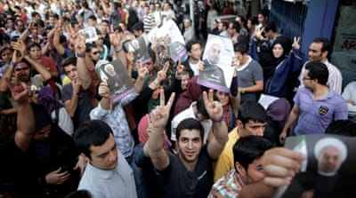 Iranians bask in Rouhani victory