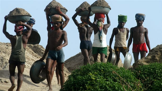 Labourers transport sand from boats to the shore after excavating it from the bed of River Yamuna in Allahabad, India [AP]