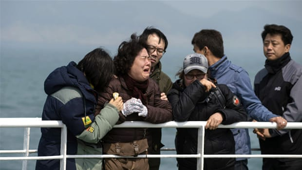 A relative weeps at the site where the ferry sank off the coast of South Korea's island of Jindo [AP]