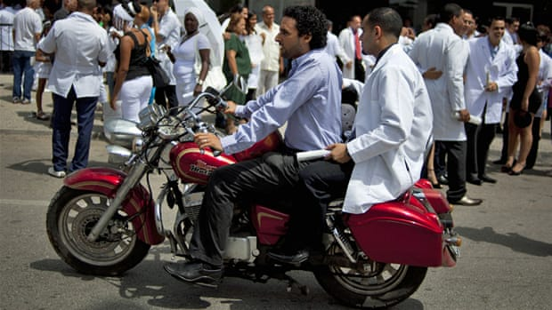A doctor walks a patient out after surgery at the Cuban Ophthalmology Institute in Havana [AP]