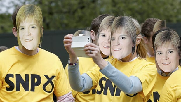First Minister of Scotland and leader of the Scottish National Party Nicola Sturgeon poses for a selfie with a supporter [Getty Images]