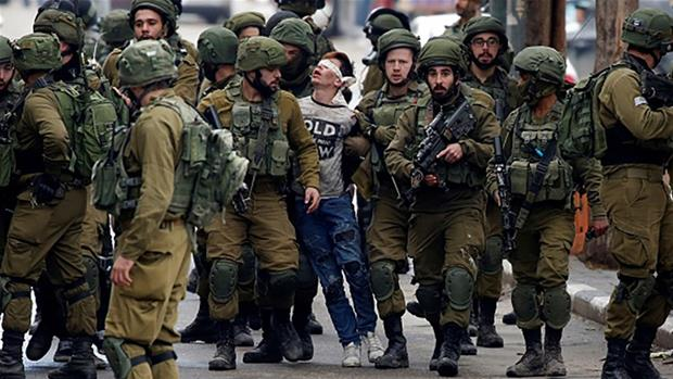 'Beaten' Palestinian boy in viral photo charged