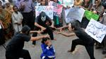 NGO workers performed during anti-rape protests where crowds demanded the arrest of the culprits [AFP]