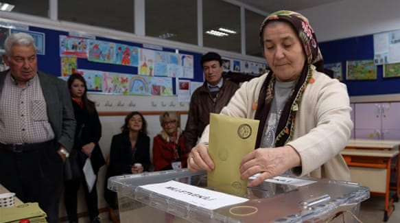 More than 54 million people are registered to vote at 175,000 stations on Sunday [Burhan Ozbilici/AP]