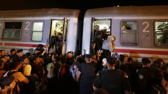 Refugee children board a bus in the Croatian capital Zagreb [Mohammed Jamjoom/Al Jazeera]