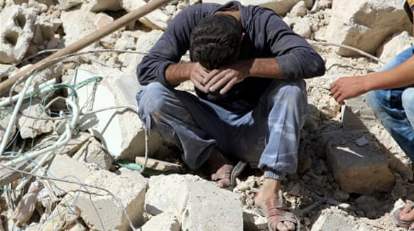 A man reacts after losing relatives to an air strike in rebel-held neighbourhood of Aleppo [Abdalrhman Ismail/Reuters]