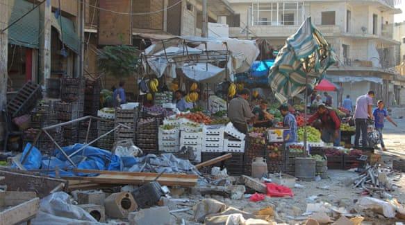 An air raid hit a market in the rebel controlled city of Idlib [Ammar Abdullah/Reuters]