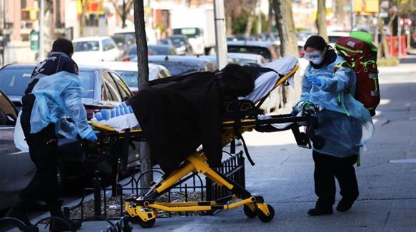 US states start to reopen as coronavirus death toll tops 50,000