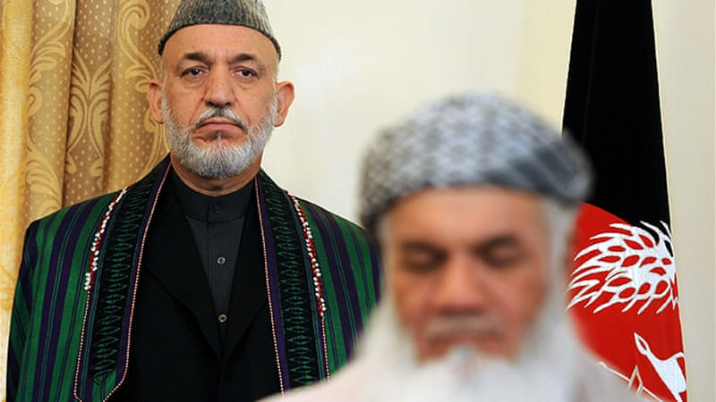 Mohammad Ismail Khan (right), pictured with current president Hamid Karzai [AFP]