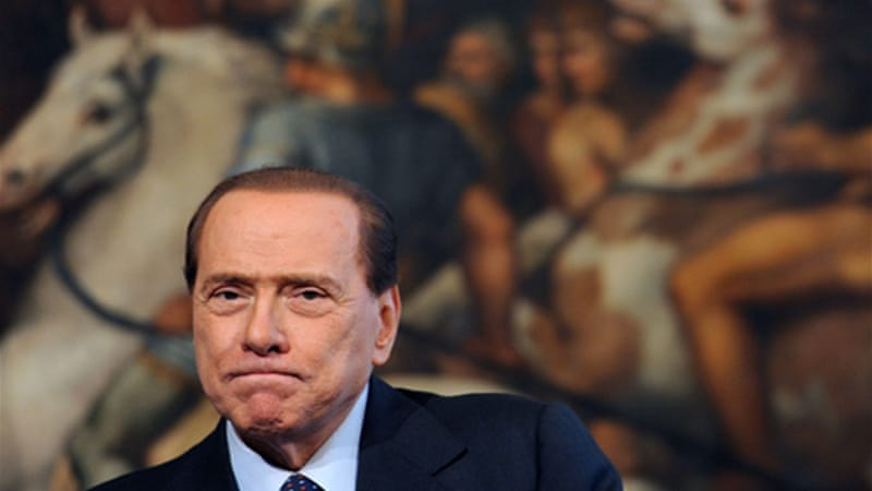 Berlusconi says he is running  for the post of prime minister 'to win' EPA]