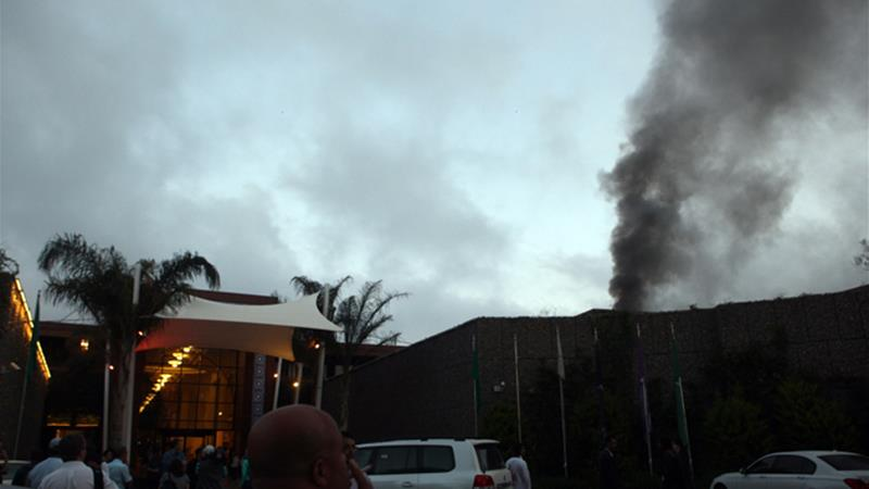Tripoli's opulent Rixos Hotel caught fire on June 9, 2011, forcing journalists to evacuate [EPA]