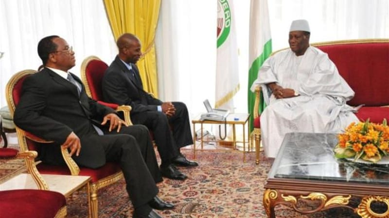 Mali's President Dioncounda Traore (left) asked African forces to help take back northern Mali from the rebels [AFP]