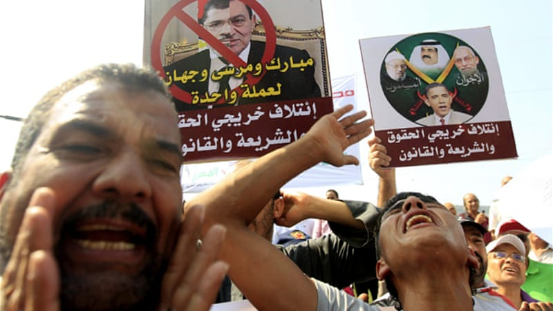 Protesters in Cairo compared President Mohamed Morsi to deposed President Hosni Mubarak [Reuters]