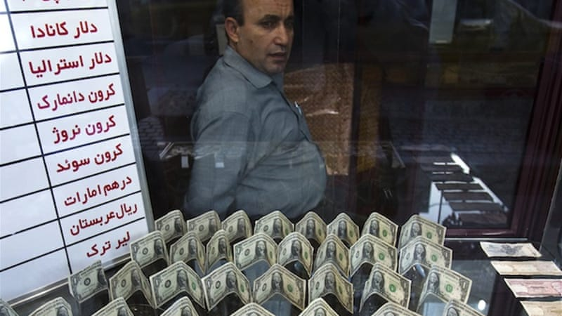 Iran blasts 'enemies' as currency plunges