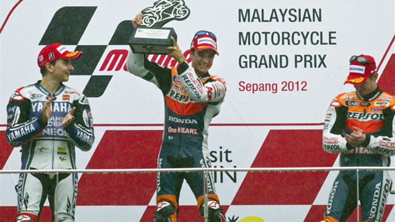 The Spaniard took a further five points off Jorge Lorenzo's lead in treacherous conditions in Malaysia after the championship leader finished second [EPA]