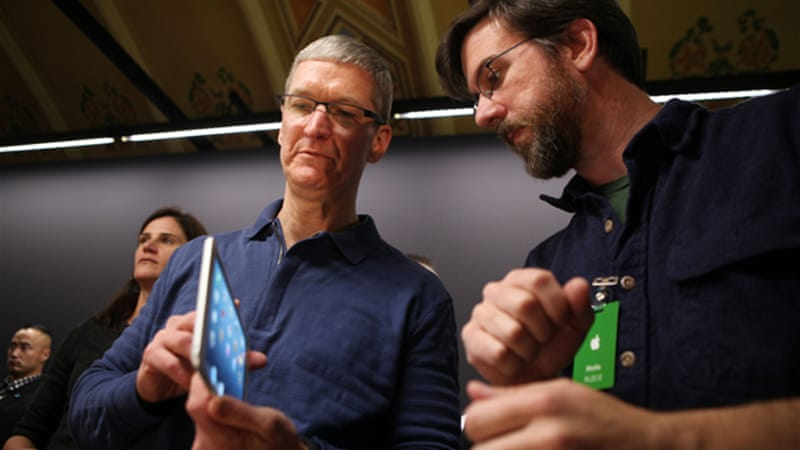 Apple CEO Tim Cook, left, has accelerated the release of new devices after taking over for the late Jobs [AFP]